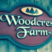 Woodcrest Farm LLC Logo